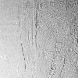 This image captured by NASA's Cassini spacecraft of Saturn's moon Enceladus, shows a region of craters softened by time and torn apart by tectonic stresses.