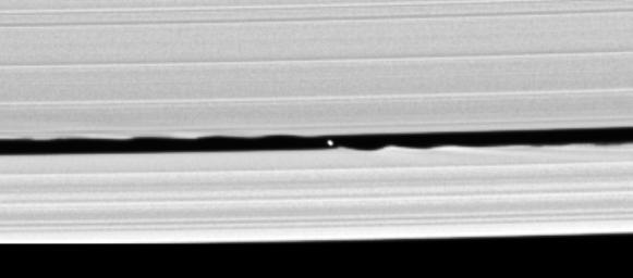 Confirmation that a small moon orbits within the Keeler gap in Saturn's rings is made all the more exciting by this image captured by NASA's Cassini spacecraft, in which the disk of the 7 kilometer-wide body is resolved for the first time.