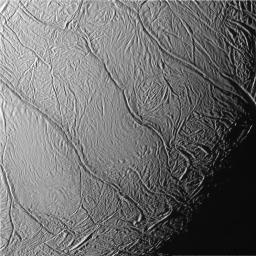 This view of Saturn's moon Enceladus captured by NASA's Cassini spacecraft, looks toward the moon's terminator and shows a distinctive pattern of continuous, ridged, slightly curved and roughly parallel faults within the moon's southern polar latitudes.