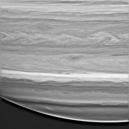 This image captured by NASA's Cassini spacecraft shows a highly detailed look at the feathery, wavelike patterns in the cloud bands of Saturn's southern hemisphere.
