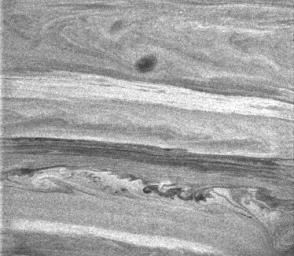 This image from NASA's Cassini spacecraft shows intricate undulations and swirls within the banded atmosphere of Saturn, which give scientists clues to the processes occurring there.