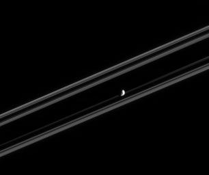 NASA's Cassini spacecraft was nearly in the plane of Saturn's rings when it took this image of Janus.