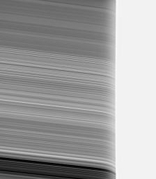 Saturn's rings appear strangely warped in this view of the rings seen through the upper Saturn atmosphere. This image from NASA's Cassini spacecraft was obtained using a near-infrared filter.