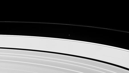Saturn's little moon Atlas orbits Saturn between the outer edge of the A ring and the fascinating, twisted F ring. This image from NASA's Cassini spacecraft just barely resolves the disk of Atlas.