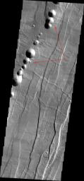 This image released on August 24, 2004 from NASA's 2001 Mars Odyssey shows Acheron Catera, a line of craters found on the flanks of Alba Patera -- a very old volcano on Mars.