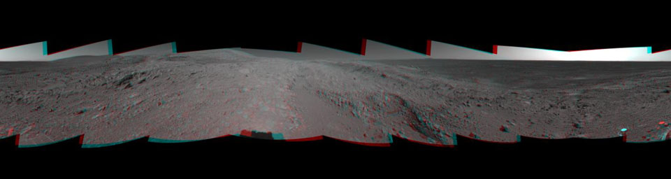 NASA's Mars Exploration Rover Spirit looked up at the 'Columbia Hills' from its location on the 265th martian day, or sol, of its mission (Sept. 30, 2004) and captured this 3-D view. 3D glasses are necessary to view this image.