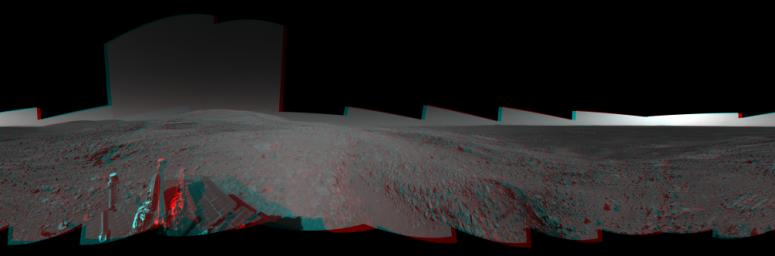 This 360-degree view combines frames taken by the navigation camera on NASA's Mars Exploration Rover Spirit during the rover's 271st martian day, or sol, on Oct. 7, 2004. 3D glasses are necessary to view this image.
