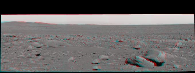 This stereo view was taken by the panoramic camera on NASA's Mars Exploration Rover Spirit on the rover's 87th martian day, or sol (April 1, 2004), just after Spirit left 'Bonneville Crater.' 3D glasses are necessary to view this image.