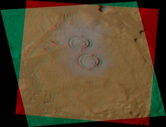 This image shows two holes created by NASA Spirit's rock abrasion tool in a rock dubbed 'Wooly Patch' near the base of the 'Columbia Hills' inside Gusev Crater. 3D glasses are necessary to view this image.