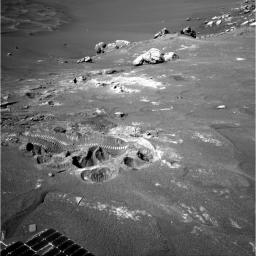 Wheel tracks from NASA's Mars Exploration Rover Opportunity show where the rover struggled for traction while driving away from 'Wopmay' rock inside 'Endurance Crater' on Oct. 29, 2004.