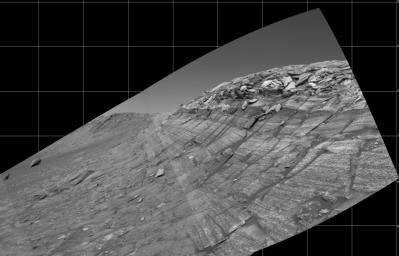 NASA's Mars Exploration Rover Opportunity captured this view from the base of 'Burns Cliff' during the rover's 280th martian day (Nov. 6, 2004). This cliff in the inner wall of 'Endurance Crater' displays multiple layers of bedrock.