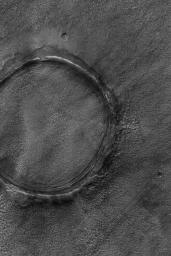 NASA's Mars Global Surveyor shows a crater's raised rim still pokes out above the surrounding plains on Mars.