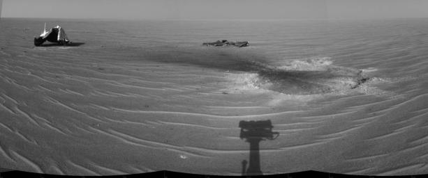 NASA's Mars Exploration Rover Opportunity gained this view of its own heat shield on Dec. 22, 2004. The main structure from the shield is to the far left. Additional fragments of the heat shield are seen. The heat shield's impact mark is visible.