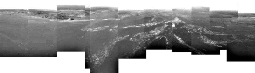 This composite was produced from images returned yesterday, January 14, 2005, by the European Space Agency's Huygens probe during its successful descent to land on Titan.
