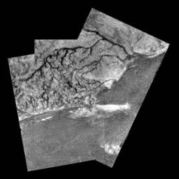 This mosaic of three frames from NASA's Huygens Descent Imager/Spectral Radiometer (DISR) instrument provides unprecedented detail of the high ridge area including the flow down into a major river channel from different sources.