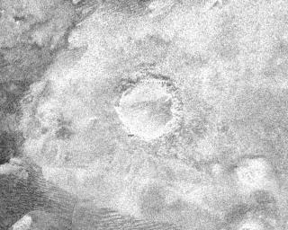 This image from NASA's Cassini spacecraft shows a crater, approximately 60 kilometers (37 miles) in diameter, on the very eastern end of the radar image strip taken by the Cassini orbiter on its third close flyby of Titan.