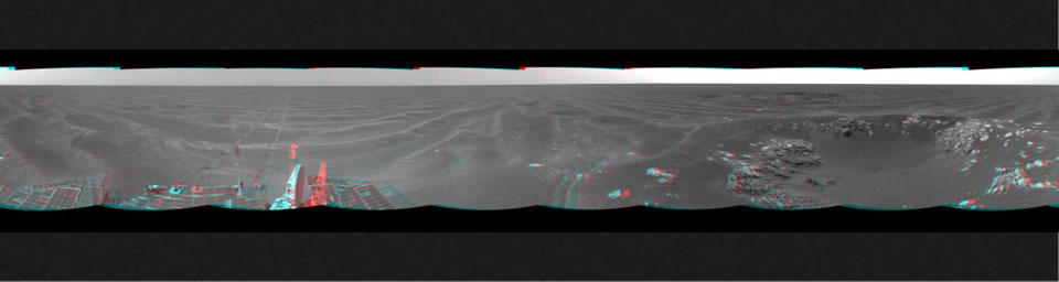 On Feb. 24, 2005, NASA's Mars Exploration Rover Opportunity had driven about 73 meters (240 feet) and reached the eastern edge of a small crater dubbed 'Naturaliste,' 3D glasses are necessary to view this image.