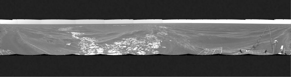 NASA's Mars Exploration Rover Opportunity took this cylindrical projection 360-degree view of the rover's surroundings on March 8, 2005 at Vostok Crater. Much of the crater is buried in sand.