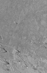 NASA's Mars Global Surveyor shows exhumation of flow surfaces from beneath a material that was eroded by wind in the Cerberus/Zephyria region of Mars.