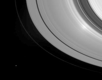 When NASA's Cassini gazes down at Saturn's rings with the Sun directly behind the spacecraft, an unusual phenomenon called the 'opposition effect' can be seen. The effect is visible here as a bright region, near right, toward the inner edge of the A ring.