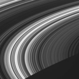 This image from NASA's Cassini spacecraft shows the unlit face of Saturn's rings, visible via scattered and transmitted light.