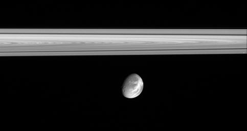 This image captured by NASA's Cassini spacecraft shows the soft appearance of Dione's wispy terrains belies their true nature. They are, in fact, complex systems of crisp, braided fractures that cover the moon's trailing hemisphere.