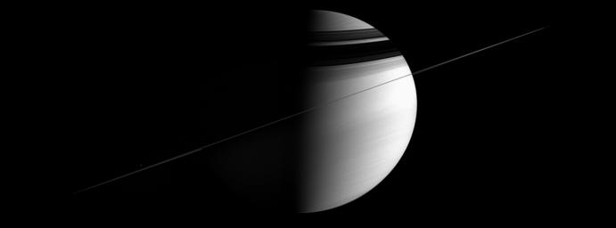 As the ringed giant tugged on NASA's Cassini spacecraft, urging it to make yet another orbit, the intrepid spacecraft took in this all-encompassing panorama.
