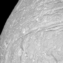 This view of the surface of Saturn's moon Tethys, taken during NASA's Cassini spacecraft's close approach to the moon on Sept. 24, 2005, reveals an icy land of steep cliffs.