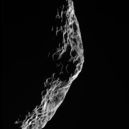 As NASA's Cassini spacecraft sped away from its close encounter with Saturn's moon Hyperion on Sept. 26, 2005, it took this parting shot of the battered moon's shadowy limb.