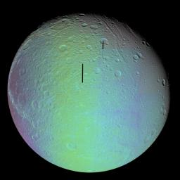 The cratered and cracked disk of Saturn's moon Dione looms ahead in this mosaic of images taken by NASA's Cassini spacecraft on Oct. 11, 2005, as it neared its close encounter with the icy moon.