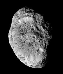 Saturn's impact-pummeled moon Hyperion stares back at NASA's Cassini spacecraft in this six-image mosaic, taken during the spacecraft's close approach on Sept. 26, 2005.
