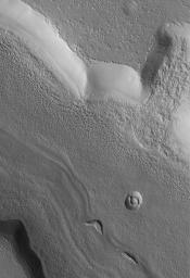 NASA's Mars Global Surveyor shows the results of a small mass movement in a fretted terrain valley in the Coloe Fossae region of Mars.