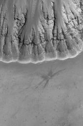 This image from NASA's Mars Global Surveyor shows a relatively fresh crater with dark, rayed ejecta on an upland plain above one of the many depressions in the eastern Labyrinthus Noctis region.