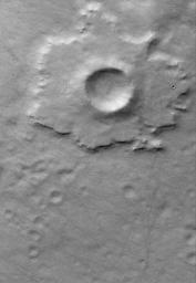 This Mars Global Surveyor (MGS) Mars Orbiter Camera (MOC) image shows a  pedestal crater in the Promethei Terra region. The ejecta from an impact  crater is usually rocky