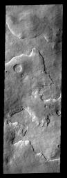This layered region is between Aonia Planum and the south pole. The edges of the top layer have a 'smoothed' appearance that may be due to ice melting.