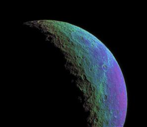 This intense false-color view from NASA's Cassini spacecraft highlights and enhances color variations across the cratered and cracked surface of Saturn's moon Rhea.