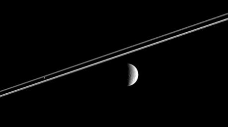 Distant Rhea (right) poses here for the Cassini spacecraft, as Pandora  hovers against Saturn's dark shadow on the rings