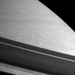 Shadows drape Saturn's northern hemisphere, providing a different kind of look at prominent features in the rings. This image was taken with NASA's Cassini spacecraft's narrow-angle camera on Feb. 18, 2006.