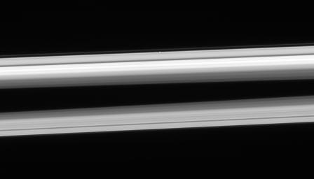 NASA's Cassini spacecraft looks up from beneath the ringplane to spy Atlas hugging the outer edge of the A ring, above center. This image was taken in visible light with the Cassini spacecraft narrow-angle camera on Feb. 23, 2006.