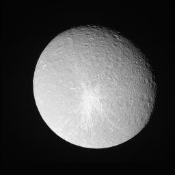 Rhea shows off her bright, fresh-looking impact crater in this Cassini  view taken during a close approach