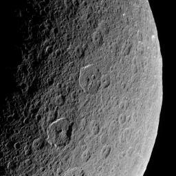 Cassini looks down upon Rhea, whose cratered surface was already ancient  before any complex life developed on Earth. The terrain seen here has  probably changed little in the past billion years