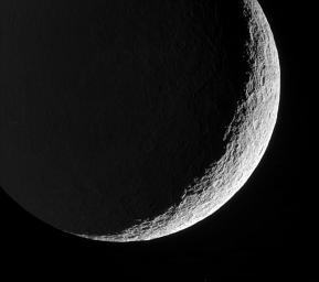 Rhea's devastated surface creates a jagged terminator as mountains and crater rims break-up the line between day and night. This image was taken in visible green light with NASA's Cassini spacecraft's narrow-angle camera on May 22, 2006.
