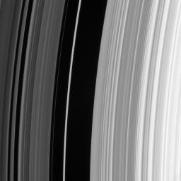 The sharp outer boundary of Saturn's B ring, which is the bright ring region seen to the right in this image, is maintained by a strong resonance with the moon Mimas. For every two orbits made by particles at this distance from Saturn