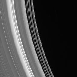 Bright ringlets and dark gaps at the inner edge of the C ring sweep across this scene. The C ring contains numerous 'plateaus' -- broad ring regions that are bright and surrounded by fainter material