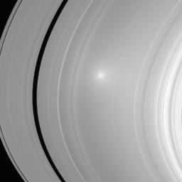Two images of Saturn's A and B ring showcase the opposition effect, a brightness surge that is visible on Saturn's rings when the Sun is directly behind the spacecraft