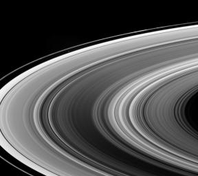 This view looks down onto the unlit side of Saturn's ringplane. It nicely shows a near-arm/far-arm brightness asymmetry in the B ring: The near arm of the B ring is notably darker from this viewing geometry than is the far arm