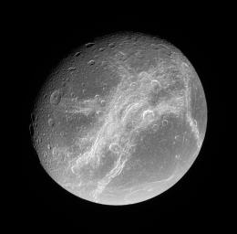 This splendid view showcases Dione's tortured complex of bright cliffs. At lower right is the feature called Cassandra, exhibiting linear rays extending in multiple directions
