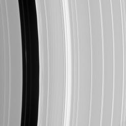 Although the embedded moon Pan is nowhere to be seen, there is a bright clump-like feature visible here, within the Encke Division. Also discernable are periodic brightness variations along the outer (right side) gap edge