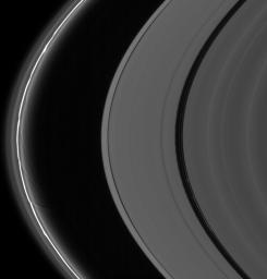 The A and F rings are alive with moving structures in this Cassini spacecraft view. Graceful drapes of ring material created by Prometheus are seen sliding by at left, while clumpy ringlets slip through the Encke Gap