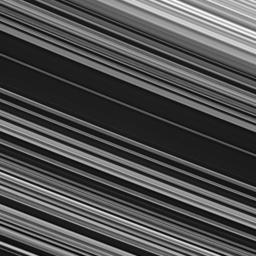 The spoke-producing region of the B ring displays fine-scale asymmetry in the azimuthal direction -- the direction along which the ring particles orbit Saturn -- from upper left to lower right across this image from NASA's Cassini.
